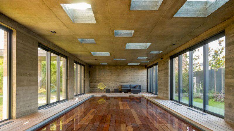 une extension moderniste, mi-piscine, mi-salle de réception fond mobile pour piscine interieure Actualité