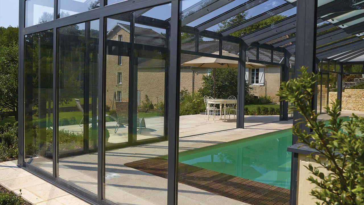Serre pour la piscine l 39 esprit piscine for Piscine avec veranda
