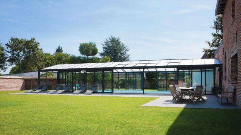 De briques et de verre piscine sous veranda darchitecte Abris de piscine Blanc
