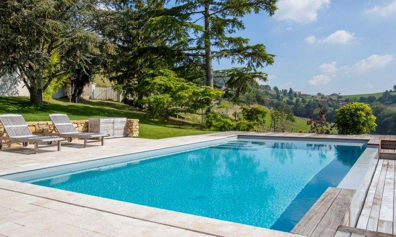 Piscine à débordement Rénovation de piscines Gris clair Une nouvelle saison