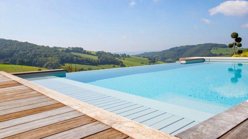 Une nouvelle saison Piscine à débordement Rénovation de piscines Gris clair