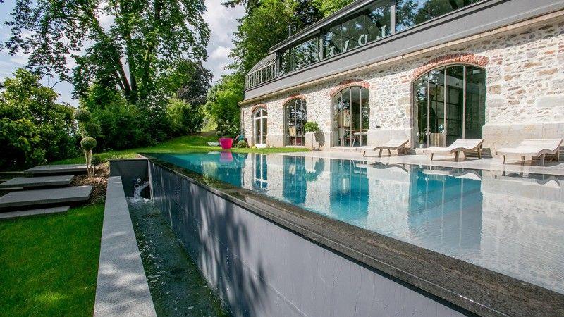 Reflets d'élégance piscine miroir design Piscine miroir minéral Gris anthracite