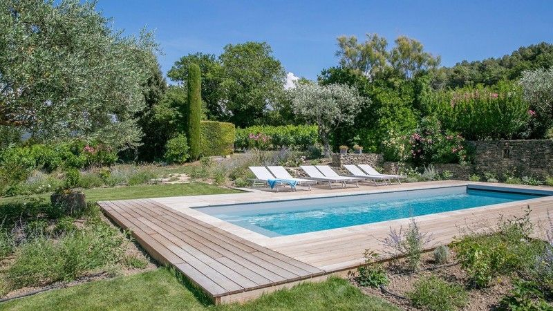 Piscine terrasse en bois exotique