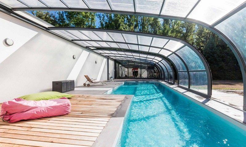 Piscine toit ouvrant l 39 esprit piscine for Veranda pour piscine