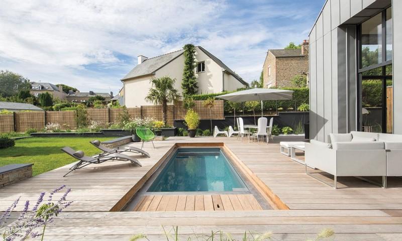 Piscine avec terrasse mobile Gris anthracite Un espace métamorphosé