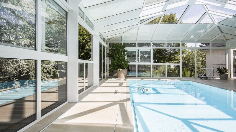 Baigné de lumière construction piscine avec veranda Abris de piscine Blanc