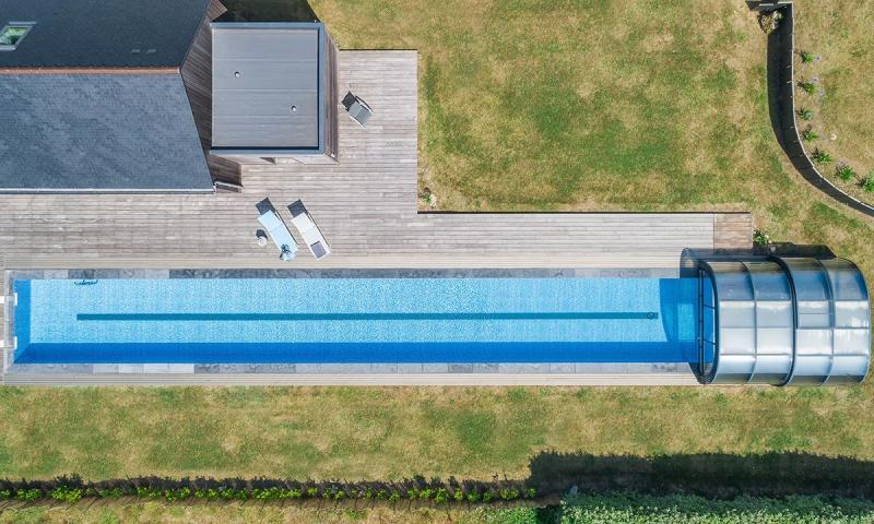 Couloir de nage Abris de piscine Un bassin hors norme