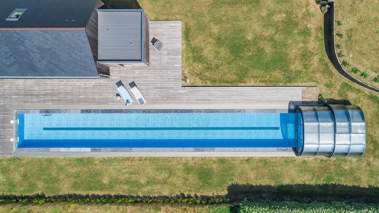 Un bassin hors norme couloir de nage 25m Couloir de nage Abris de piscine